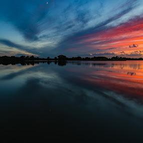 Sunset and the crescent moon by Matt Hollamon - Landscapes Sunsets & Sunrises ( clouds, water, reflection, sunset, yankee hill, lake, nikon, nikon d500, tokina, nebraska, rural, sun rays,  )