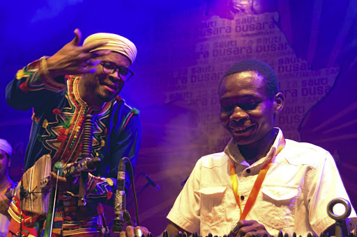 Foulane Bouhssine (left) and Gora Mohammed perform on the Sauti za Busara main stage