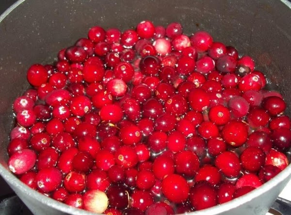Add the cranberries and cook for about 5 minutes. Cranberries will begin to pop...