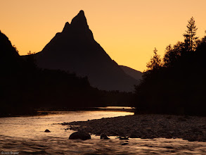 Photo: Otertind is silhouetted by the summertime midnight sky in northern Norway.