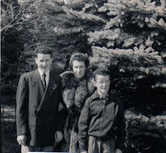 Photo: Fr. Jim with mother Mary and brother Mike
