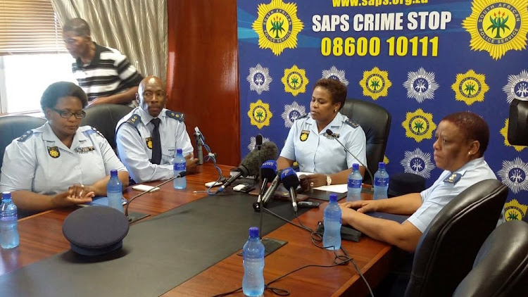 North West Police Commissioner Lt-General Baile Motswenyane (second from right) applauded an officer who arrested three people who attempted to bribe him.