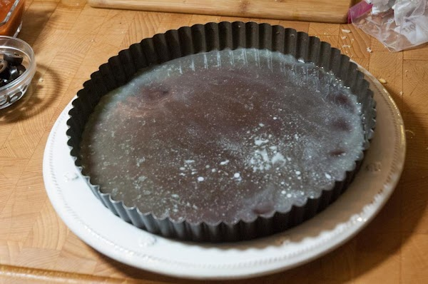 Add the melted butter to the bottom of the tart pan.