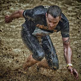 by Marco Bertamé - Sports & Fitness Other Sports ( water, brwon, 1308, splatter, differdange, splash, 2015, number, soup, running, luxembourg, muddy, strrong, strongmanrun, man )