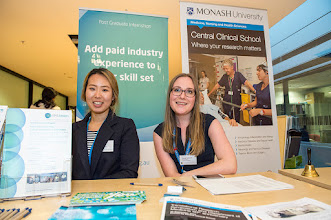 Photo: Erica Kim (Medicine graduate student supervised by Dr Steven Petratos) and Ms Dussy Kuttner, helping out with information. http://www.med.monash.edu.au/cecs/events/2015-tr-symposium.html