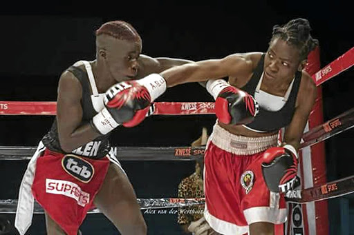 Smangele Hadebe, left, and Ellen Simwaka exchange blows in their previous fight. They meet again on Saturday.