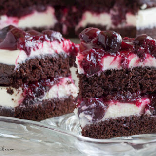 Rich Chocolate Cake with White Chocolate Mousse and Cherry Sauce.