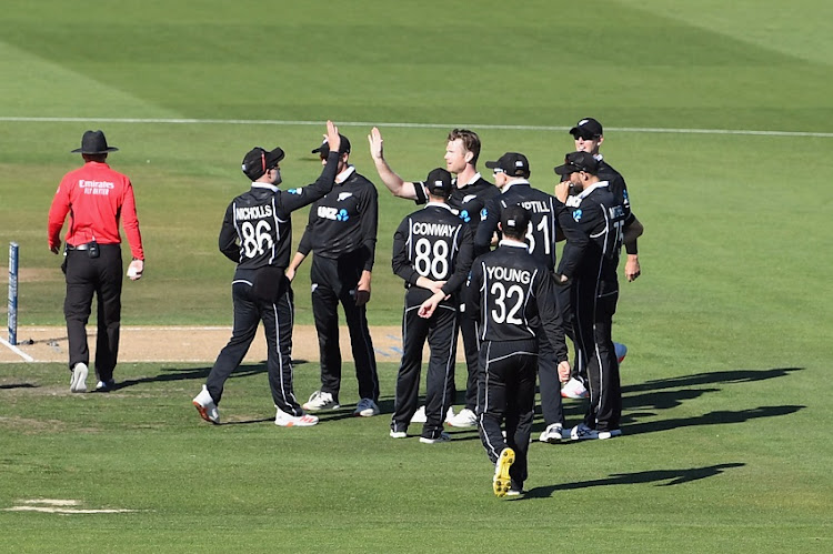 James Neesham of New Zealand (C) is congratulated by team mates after dismissing Tamim Iqbal Khan of Bangladesh during game two of the One Day International series between New Zealand and Bangladesh at Hagley Oval on March 23, 2021 in Christchurch, New Zealand.