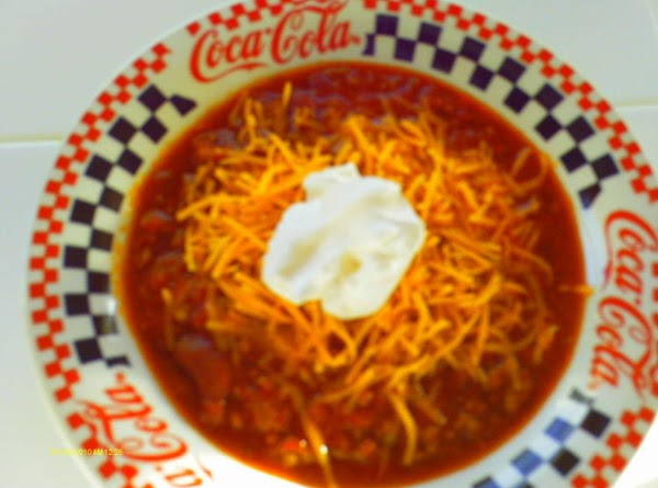 Serve with shredded cheese, sour cream, cornbread, Tostitos, Fritos or your favorite chips or...