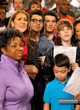 """Photo: HOLLYWOOD - FEBRUARY 01:  (L-R) Singers Gladys Knight, Celine Dion, Joe Jonas, Kevin Jonas and Justin Bieber perform at the """"We Are The World 25 Years for Haiti"""" recording session held at Jim Henson Studios on February 1, 2010 in Hollywood, California.  (Photo by Kevin Mazur/WireImage)"""