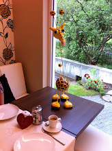 Photo: Our jolly giraffe breakfast companion