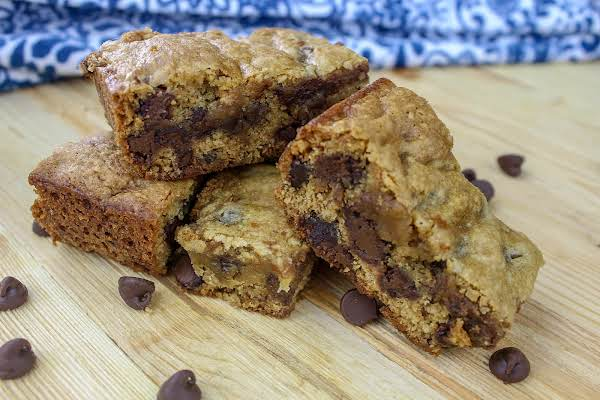 A Stack Of Honey Peanut Butter Banana Chocolate Chip Bars.
