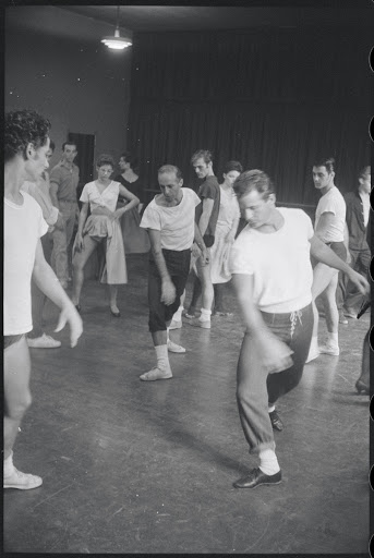 Jerome Robbins directing dancers in rehearsal for the stage production West Side Story