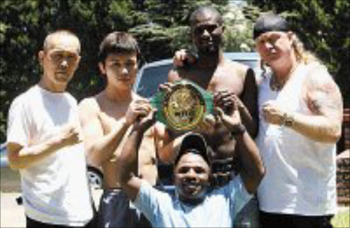 RUMBLE: Yoshinori Miyata and Jeffrey Mathebula are flanked by the Japanese boxer's trainer, Yoshutami Januka and the Mongoose's manager, Nick Durandt. Holding the WBC international belt is promoter Jacob Matlala . Pic. Mbuzeni Zulu. 18/02/08. © Sowetan.