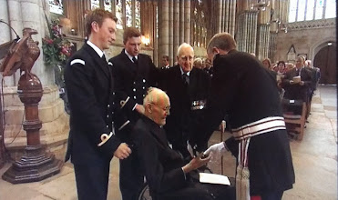 Photo: 2013 Lt Cdr Jim Perrin RD RNR receiving his Arctic Star from the Lord Lieutenant