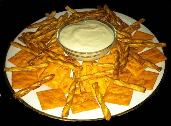 Sweet Dip With Crackers And Pretzels.