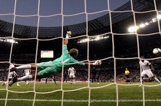 Photo: Joe Hart of England dives to make a save during the UEFA EURO 2012 group D match between France and England at Donbass Arena on June 11, 2012 in Donetsk, Ukraine.