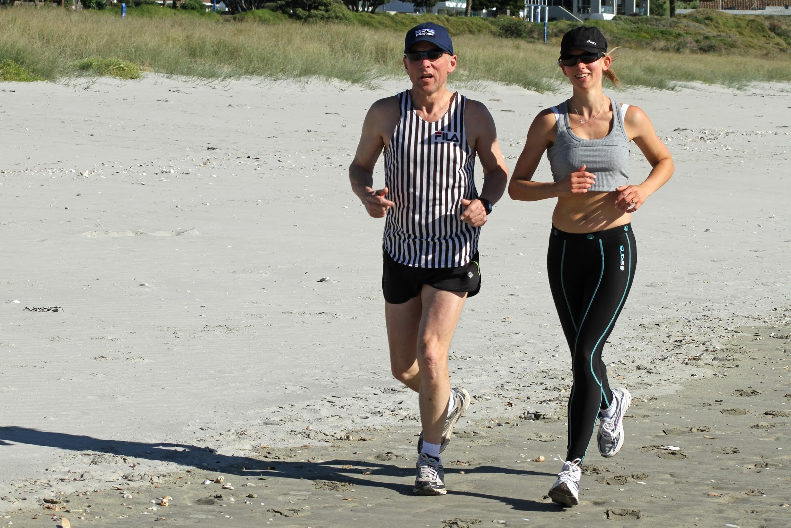 Ian_and_Susan_jogging_on_Maunganui_beach_3_(5644495596).jpg