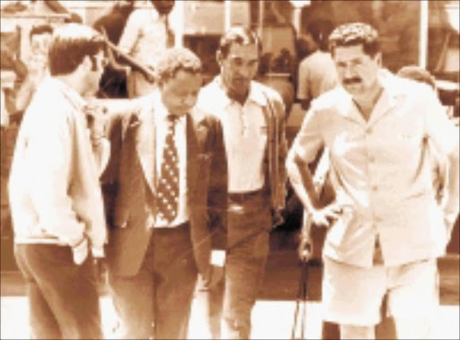 FLASHBACK: On 19 October 1977 the World editor Percy Qoboza, second left, is escorted by security police into detention. He was imprisoned for five months under the Internal Security Act. 01/01/2000. ©  Sowetan.