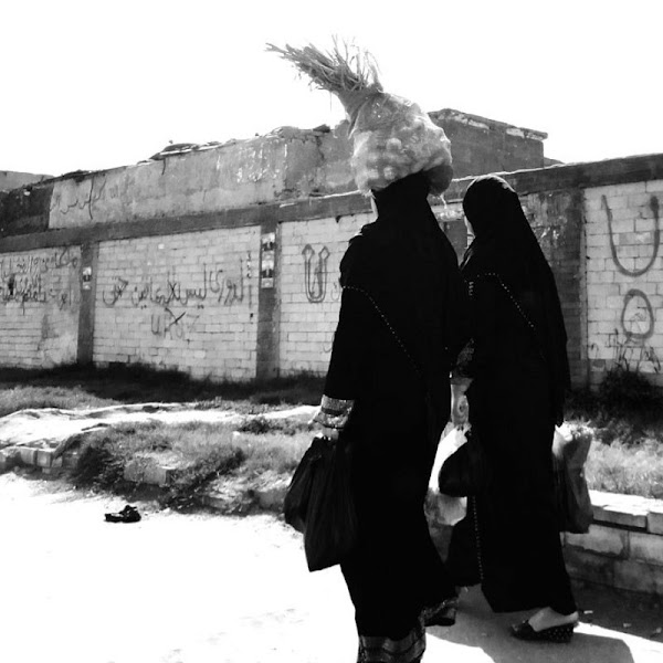 Photo: Day 115 +G+ 365 Project : 24 April 2012 She walks with bag of onions on her head. Daily life in Cairo, Egypt  BlackandWhite this week's #365weeklytheme #365project  #egypt #streetphotography #cairo #peopleandlife +PeopleandLife