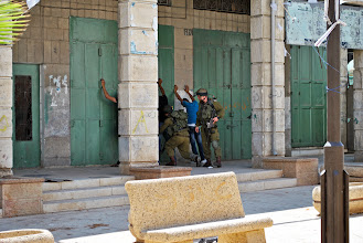 Photo: Israeli soldiers stop and search two Palestinian men at random in the Old City of Hebron, West Bank. Here is just a small glimpse into the daily indignities of life under occupation.