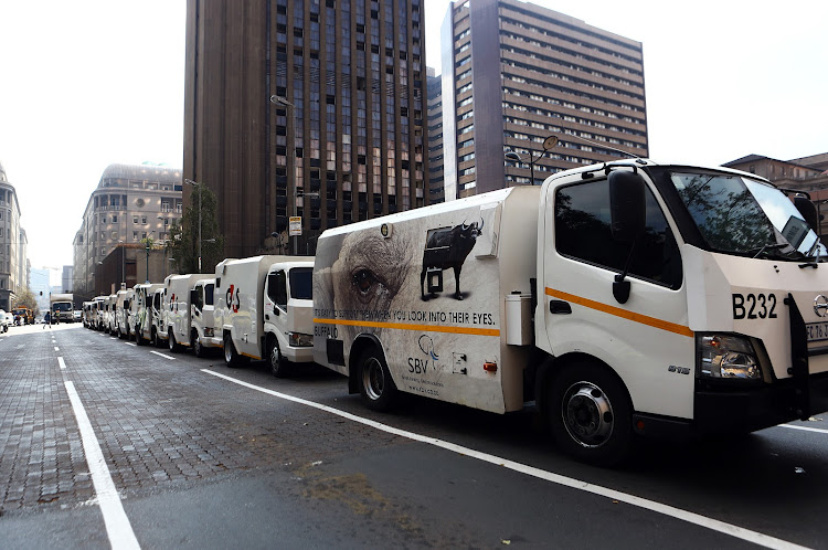 Cash-in-transit vans along Beyers Naude Square. Picture: MASI LOSI
