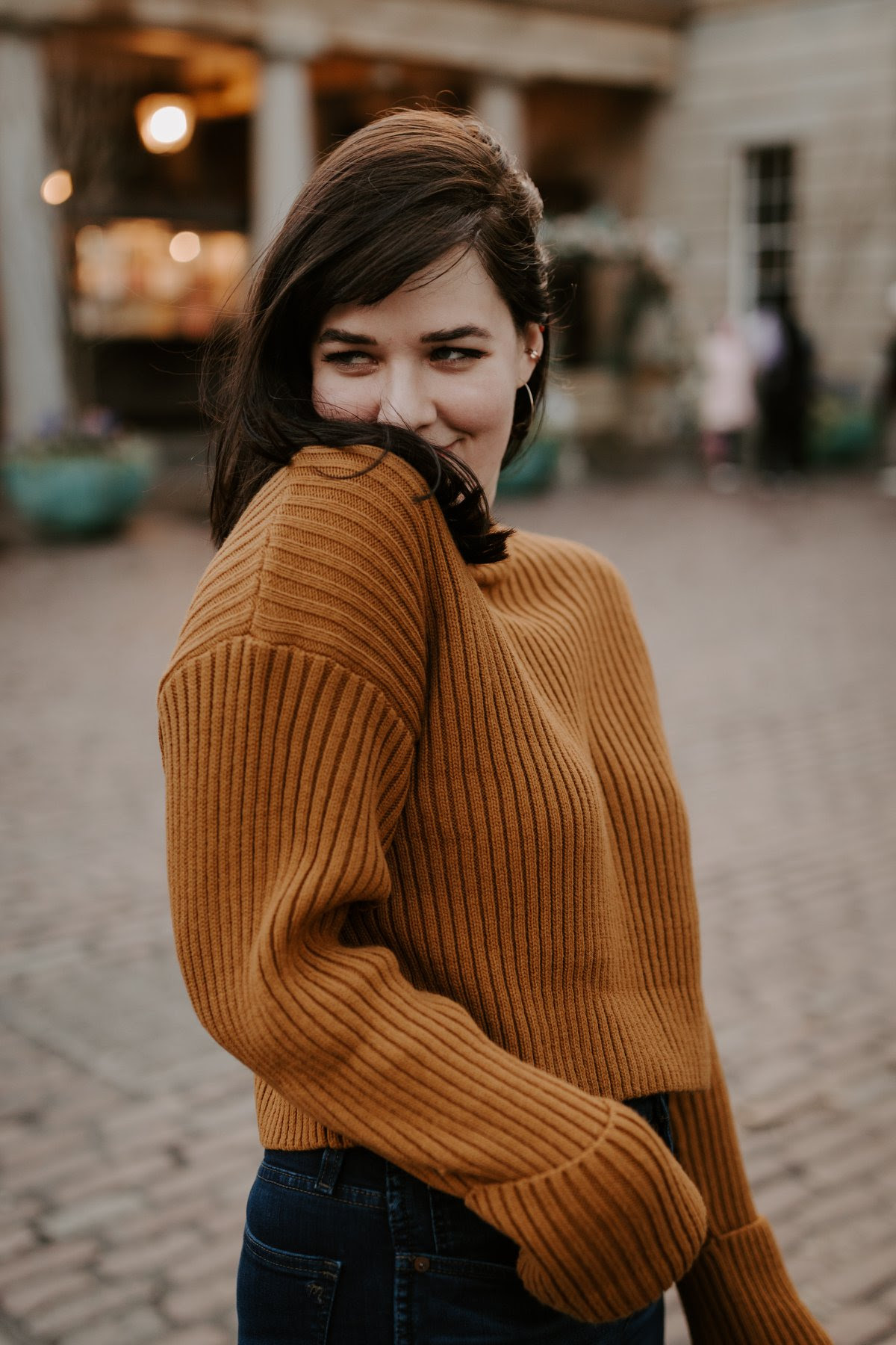 Mackenzie Taylor being incredibly cute and coy in an oversized sweater that only she can pull off