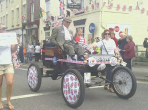 Photo: headed by an old vintage car decked out with Union Jacks.