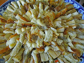 Photo: grilled eggplant strips arranged on platter