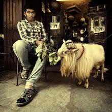 Photo: Man and goat bonding at the Chor Bazaar, Mumbai, India.  www.michiel-delange.com #streetphotography  #streetphotographers  #mumbai  #india