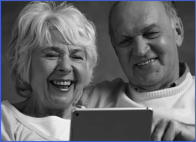 Husband uses tablet with wife with dementia