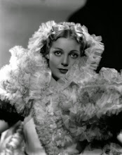 """Photo: Elaborate fabric demonstrates the photograph's sharpness, while also promoting the same visual fascination as in other photos.  The fabrics (the ruffles, the hair ribbon) also connote luxury.  The caption of the photo as posted: """"1934: American actress Loretta Young (1913 - 2000) wearing a frothy costume designed for her role in the Fox film 'Caravan', directed by Erik Charell."""""""