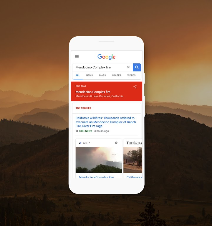 Phone with SOS Alert feature displaying wildfire information