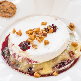 Black Currant and Walnut Stuffed Baked Brie