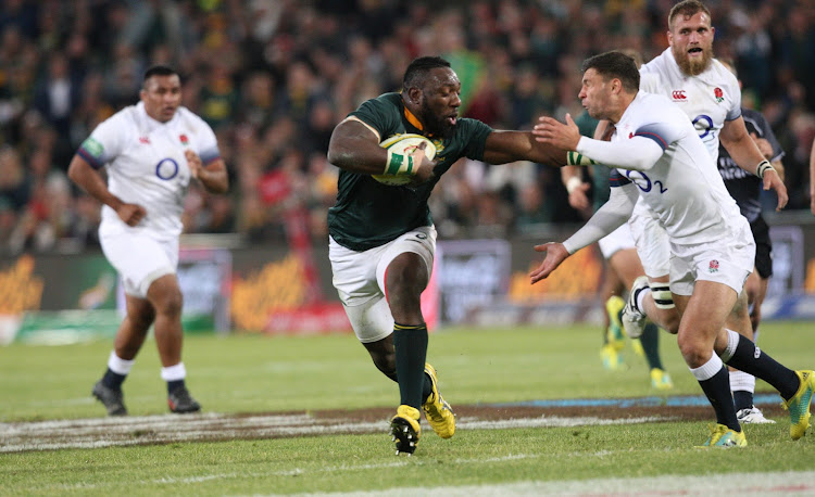 Beast Mtawarira of the Springboks playing his 100th test match makes his way pat an England player during the second incoming series test at the Toyota Stadium in Bloemfontein.