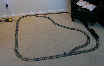 Photo: A loop of Train Track, with a Star Wars Train passing by.