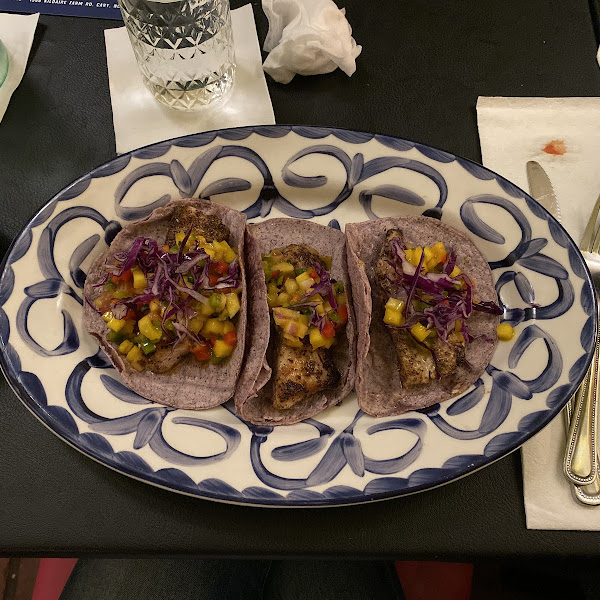Fish tacos on blue corn tortilla