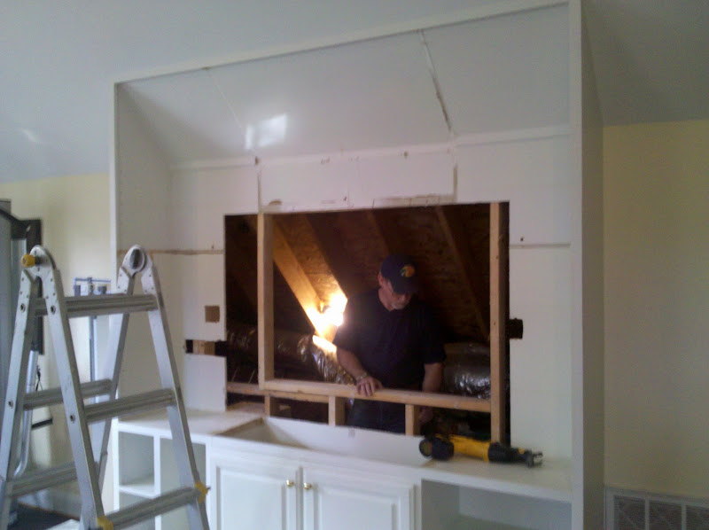"""Photo: We needed to create a larger recessed area in the cabinet to accomodate the 82"""" television we wanted to use."""