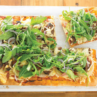 Potato, Bacon and Sausage Pizza with Fresh Arugula Topping.