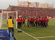 Orlando Pirates players during their pre-match pitch walkabout before their 2013 Caf Champions League second leg final against Al Ahly of Egypt in Cairo. The players were greeted with boos from the packed stadium.