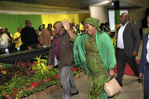 A jubilant Nkosazana Dlamini-Zuma arrives to a rapturous applause at the closing session of the KZN ANC provincial general council in Durban yesterday.
