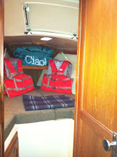 Photo: V berth with opening hatch and opaque deck window, two cabin lights and 110 plug, matching filler cushion included for sleeping