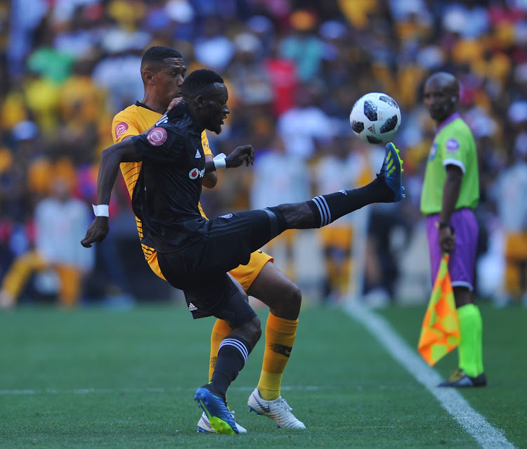 Augustine Mulenga of Orlando Pirates is challenged by Mario Booysen of Kaizer Chiefs during the Absa Premiership match at FNB Stadium in Johannesburg on October 27, 2018 at FNB Stadium.