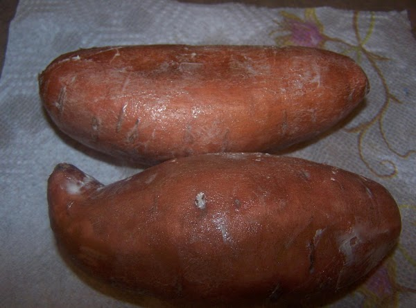 Rub each potato on all sides with softened butter.