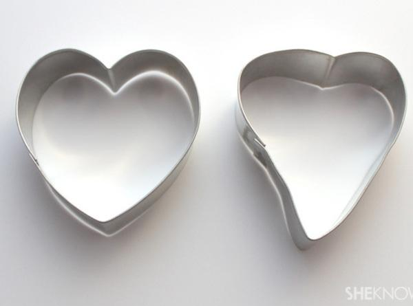 Using a heart-shaped cookie cutter, bend it slightly into the shape of a T-bone...