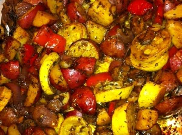 Yellow Squash, Mushrooms, Red Peppers, Red Onions And Red Potatoes Are Roasted With Olive Oil, Balsamic Vinegar, And Herbs In This Easy Side Dish.