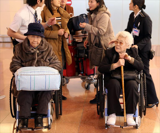 Lee Ok-seon (R) and Kang Il-chul arrive in Tokyo, Japan, 25 January 2016, for appearances to testify on their sufferings as 'comfort women.' File photo