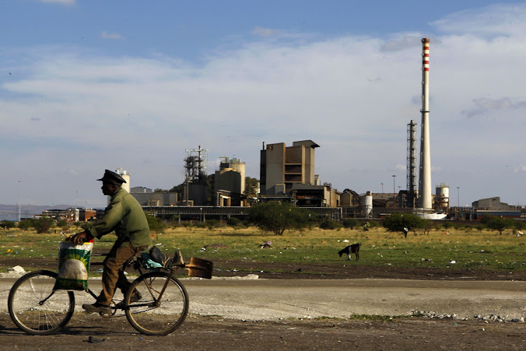 A man rides his bicycle past the Lonmin mine outside Rustenburg, northwest of Johannesburg. Picture: REUTERS