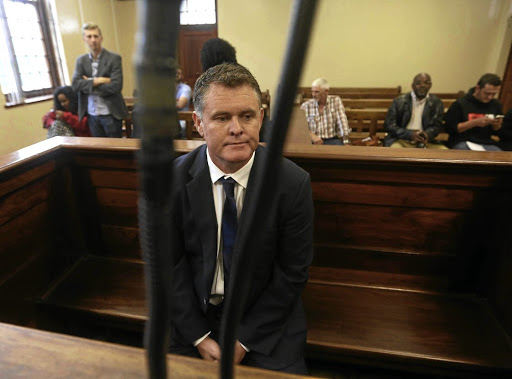 Jason Rohde sits in the dock, accused of murdering his wife, Susan A psychiatrist's report describes his rise from menial jobs to that of a property CEO.
