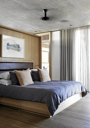 In the main bedroom, the oiled-oak bed unit was designed by Malan Vorster.